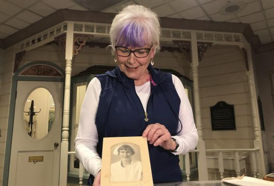 Nurse practitioner Sigrid Stokes holds a photo of her mother. Kristine Berg Mueller was a 14-year-old hospital volunteer in Norway during the 1918 flu pandemic. (AP/Haven Daley)