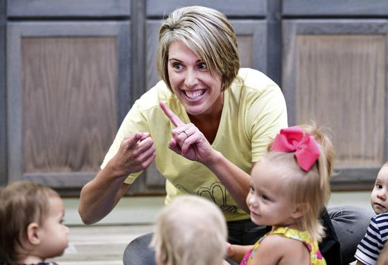 Abbey Cook shows sign language to babies and toddlers and their parents during a Communication Junction class in Illinois. (AP)