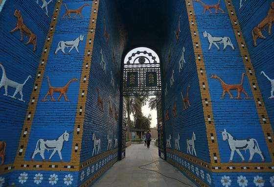 People walk near the Ishtar Gate at the archaeological site of Babylon in Iraq. (AP)