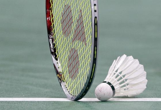 A lightweight racket and a shuttlecock with cork nose and feathered tail (AP)