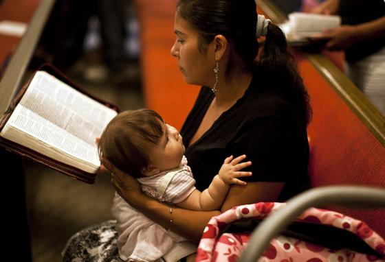 "A woman reads her Bible. What does God's word say about ""heart blindness?"" (AP)"