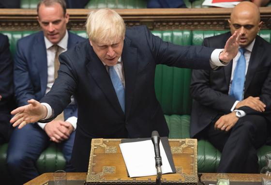New prime minister Boris Johnson argues in front of British leaders. (AP)