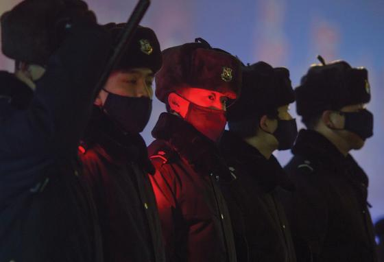 Police officers keep an eye on a church in Beijing, China. (AP)