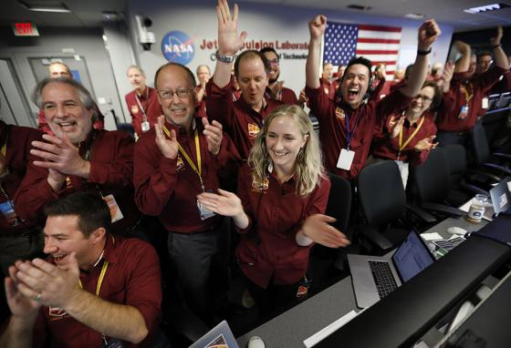 At NASA's Jet Propulsion Laboratory in Pasadena, California, engineers cheer as the InSight lander touches down on Mars. (AP)