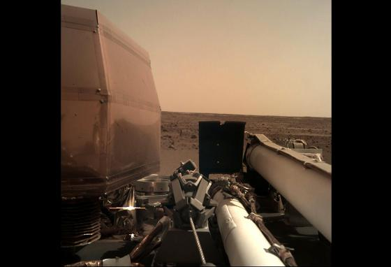 On the surface of Mars, the InSight lander uses its robotic arm-mounted camera to take a picture of the Red Planet. (AP)