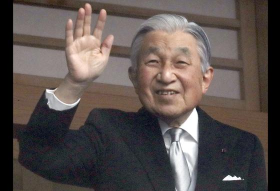 Japan's Emperor Akihito waves to well-wishers gathered outside the Imperial Palace in Tokyo. (AP)