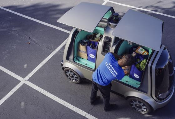 Grocery bags are loaded into the R1 autonomous vehicle. The Kroger Company plans to begin testing driverless delivery.  (AP)