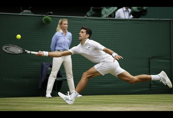 Serbia's Novak Djokovic returns the ball to Switzerland's Roger Federer at this year's Wimbledon Tennis Championships in London, England. (AP)