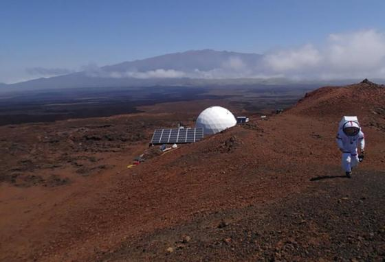 A crew member walks on Hawaii's Mauna Loa, site of the mock Mars mission. (AP)