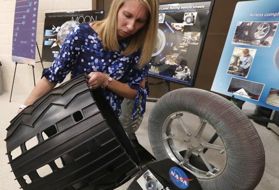 Heather Oravec holds a spare aluminum tire for the Mars Curiosity rover in the Simulated Lunar Operations Lab in Cleveland, Ohio. (AP)