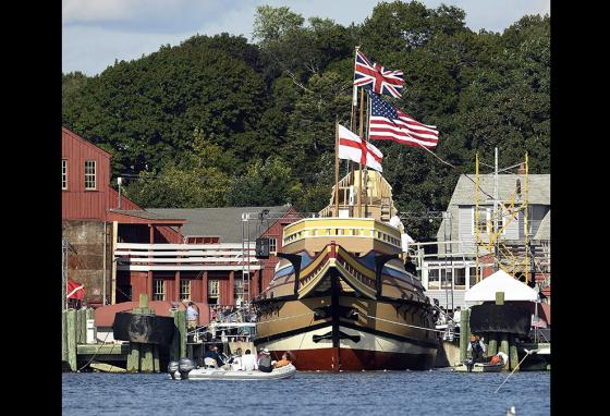 From across the Mystic River in Connecticut, the Mayflower II can be seen afloat after a re-launch ceremony. (AP)
