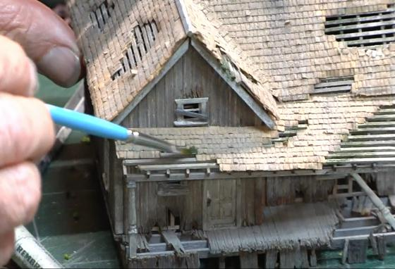 Todd Gieg brushes the roof of a scratch-made model building. (T. Gieg)