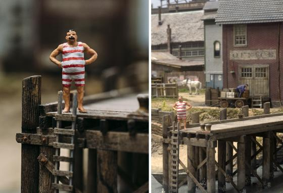 A man on a dock gets ready for a swim in the ocean in Todd Gieg's diorama of 1895 Lynn, Massachusetts. (AP)
