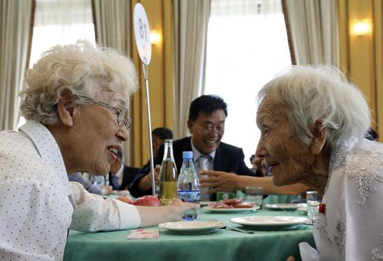South Korean Cho Hye-do, 86 (left), and her North Korean sister Cho Sun Do, 89, have a lot to talk about. But can they speak freely at the closely watched reunion event? (AP)