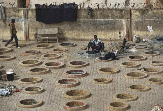 A lone craftsman dyes cloth with indigo in one of the ancient dye pits of Kofar Mata in Kano, northern Nigeria. (AP)