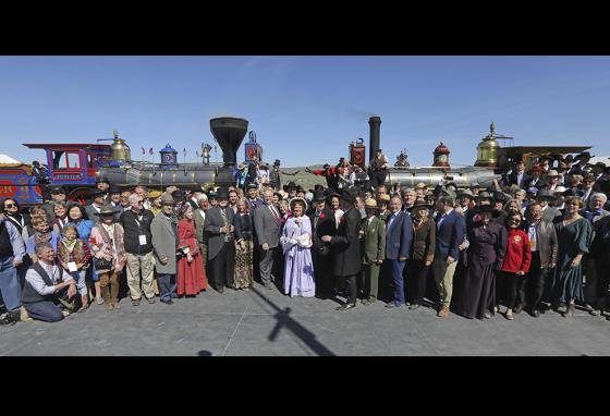 People in old-time clothing recreated the historic photo of the meeting of the rails on the 150th anniversary of the completion of the Transcontinental Railroad. (AP)