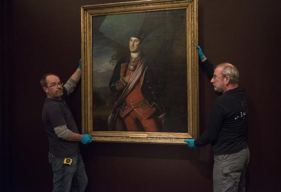 Workers prepare to install a 1772 portrait of George Washington by Charles Willson Peale in the Donald W. Reynolds Museum at Mount Vernon. (AP)