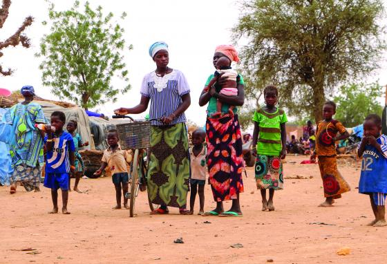 Women and children walk through a makeshift site for displaced people in Kongoussi, Burkina Faso. (AP)