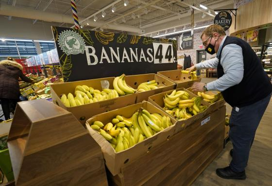 Lidl employee Joseph Lupo arranges bananas in the produce aisle in Lake Grove, New York. (AP/Kathy Willens)