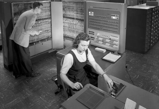 Early computers used to take up entire rooms. This one is called an IBM type 704 electronic data processing machine. It made math calculations for research.
