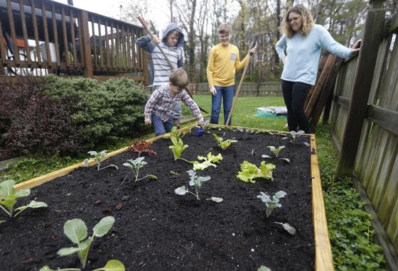 Social distancing and school closures gave families more time together to do fun projects, like gardening. (AP)
