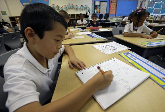 Jaeden Alvarez practices cursive writing at Cleveland K-6 School in Dayton, Ohio. These days, cursive writing is not taught in many schools. (AP/Al Behrman)