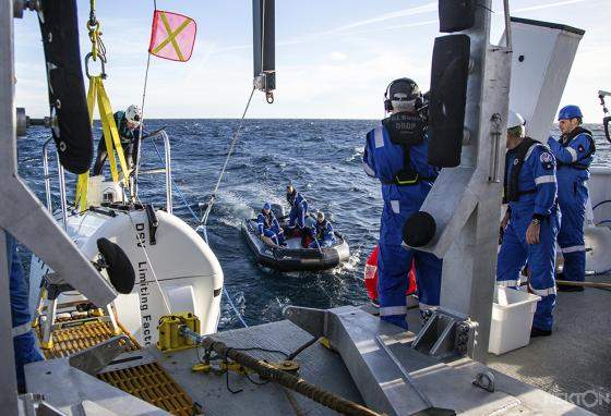 "A team of scientists launches a submarine for tests. They're preparing to dive deep into the Indian Ocean—into the ""Midnight Zone."" (AP)"