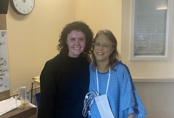 Margaret Stegall visits Janet Thorin in the hospital after the surgery on March 8, 2021. Mrs. Thorin's skin color is a result of jaundice, a side effect of her liver disease.