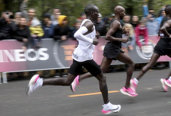 Kenyan marathon runner Eliud Kipchoge (white jersey) wears the Nike AlphaFly prototype shoes in the first sub-two-hour marathon. (AP)