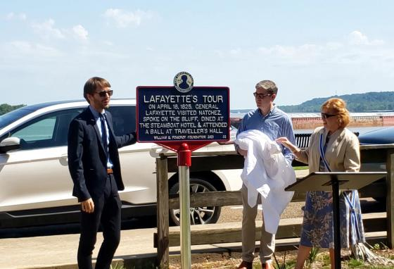 People unveil a Lafayette's Tour marker on Silver Street in Natchez, Mississippi, on June 16, 2021. (AP)