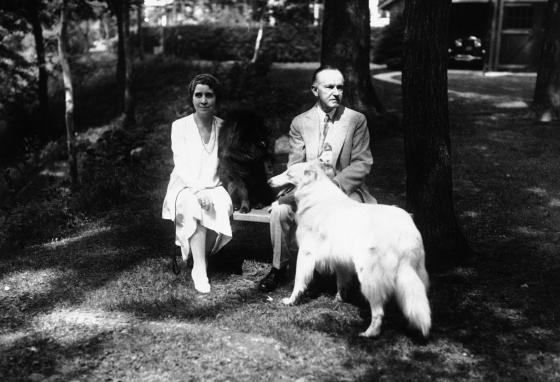 President Calvin Coolidge and First Lady Grace Coolidge pose with some of their pet dogs on June 6, 1930. (AP)
