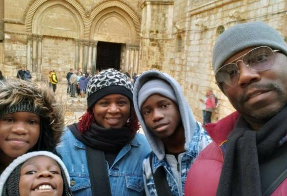 The Brown family visits the Church of the Holy Sepulchre in Jerusalem in 2019. Parents Tammy and Jayson have been taking their kids on educational trips for five years. (Jayson E. Brown via AP)