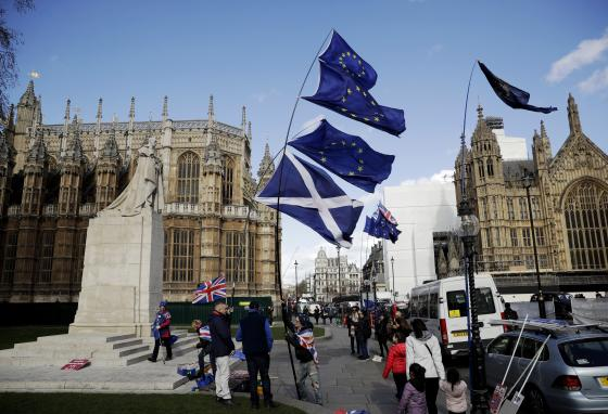 A Scottish flag, center bottom, is held up alongside European Union flags. These protesters supported Britain remaining in the European Union. (AP/Matt Dunham)
