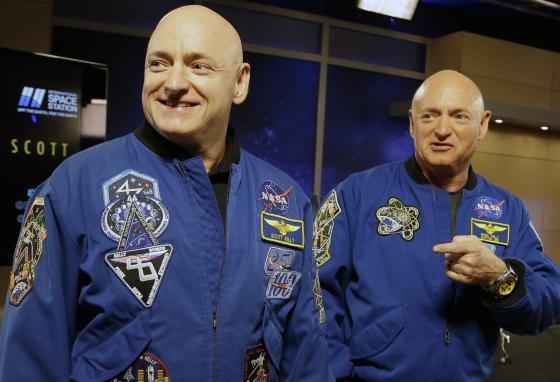 NASA astronaut Scott Kelly, left, and his twin Mark get together before a press conference in Houston, Texas, in 2016. Mark was retired as an astronaut but agreed to be part of the twins study. (AP)
