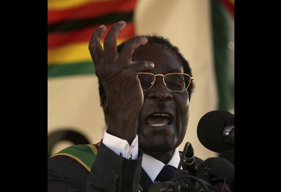 President Robert Mugabe delivers a speech in Zimbabwe. People blame Mr. Mugabe for taking land from farmers. (AP)