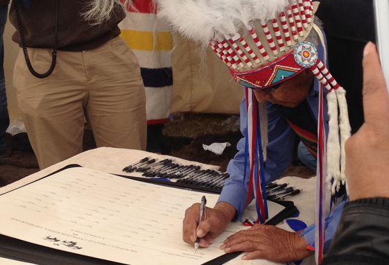 Chief Earl Old Person of the Blackfeet Nation signs the Buffalo Treaty near Browning, Montana.