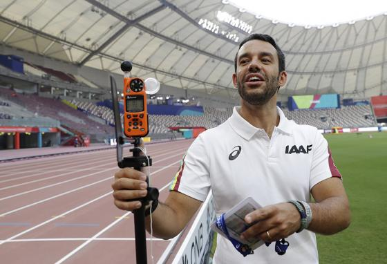 Dr. Paolo Adami explains the use of a heat-measuring sensor pill at the World Athletics Championships in Doha, Qatar. (AP)