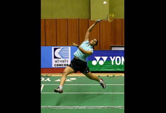 A seventeen-year-old Saina plays a shot during a Championship match in Patna, India. (AP)