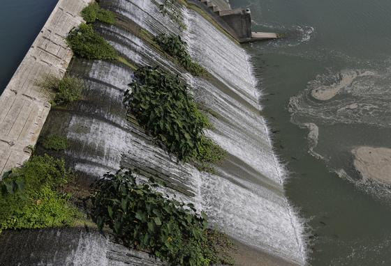 Water flows over a spill gate on Lake McQueeney. A judge has issued a 12-month halt to draining of McQueeney and five other lakes. (AP)