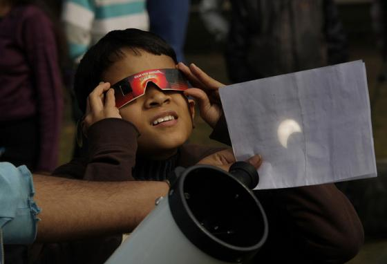Use only glasses made for viewing an eclipse or a safe projection method. (AP)