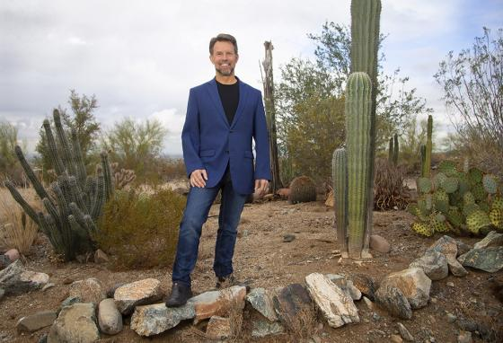 Geodesist (one who measures the earth to determine exact coordinates of any point) Michael Dennis, in the foothills of South Mountain, in Laveen, Arizona. (AP)