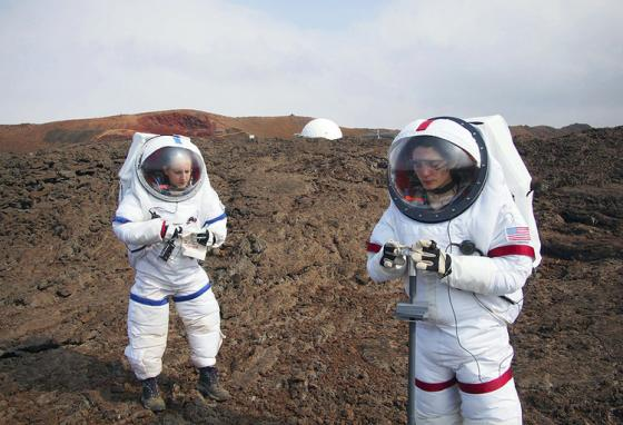 Crew members from HI-SEAS IV walk the Mars-like terrain of Hawaii's Mauna Loa. (HI-SEAS)