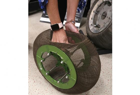 Ms. Oravec, a research associate professor stationed at the NASA Glenn Research Center, demonstrates on a tire made of the nickel titanium shape-memory alloy. (AP)