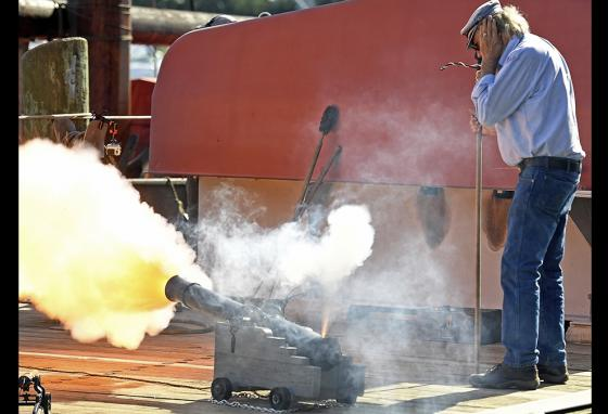 Chip Sowalski fires a cannon to salute the re-launch of the Mayflower II at the Mystic, Connecticut, Seaport Museum's H.B. duPont Preservation Shipyard. (AP)