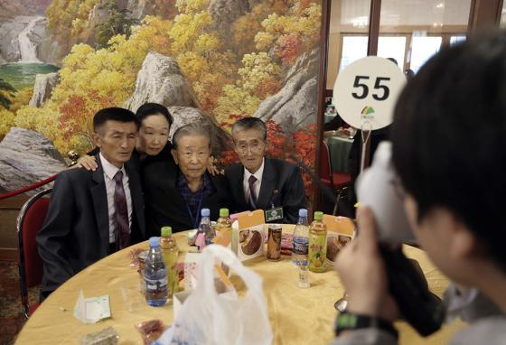 Photos, photos, and more photos were part of the meetings with relatives. Most hadn't seen each other since being separated by the Korean War. (AP)