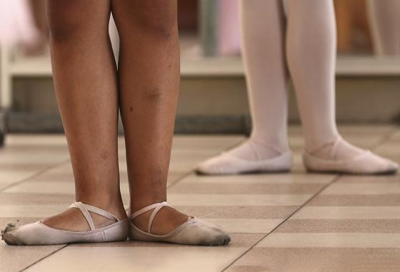 On any given afternoon, excited parents peer through the studio's windows to watch their daughters. Many are experiencing ballet for the first time. (AP)