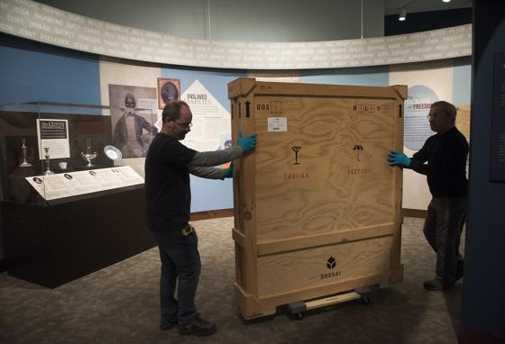 Museum services workers roll a crate containing a painting that is the youngest-known depiction of George Washington. (AP)