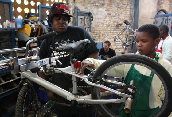 Sometimes you need a teacher, like these kids in Chicago learning how to how to fix a bicycle. (AP)