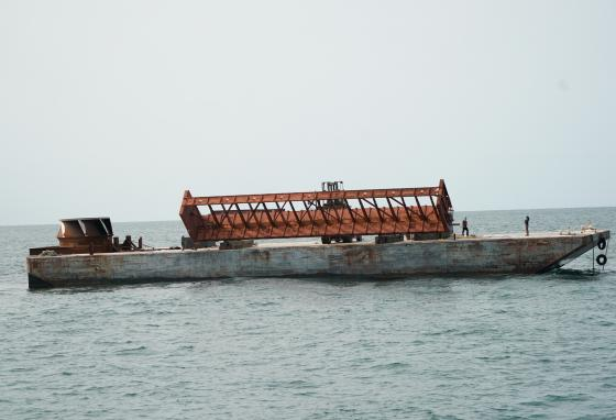 A rail car is tipped into the water. Each car was cleaned up before it was dumped. (AP)