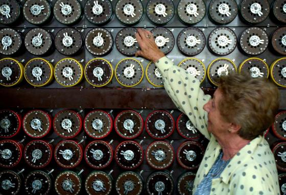 Former operator Jean Valentine stands in front of a restored Turing Bombe. During World War II, Turing Bombe machines cracked 3,000 enemy messages each day. (AP)